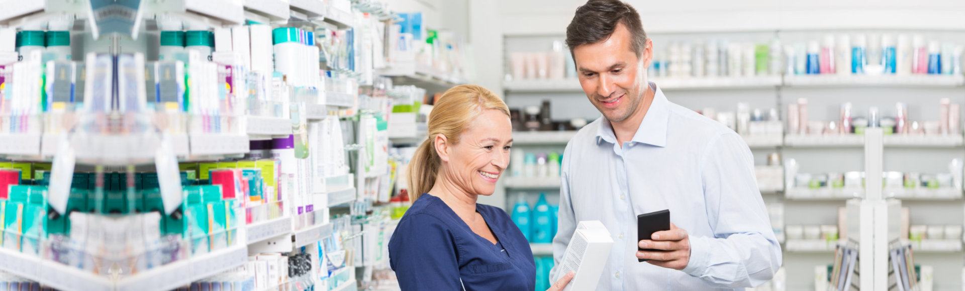 pharmacist assisting patient in buying medicines