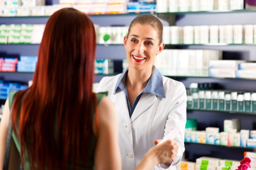 female pharmacist consulting a female customer in a drugstore